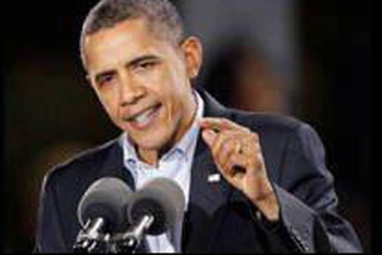 Obama fait encore campagne après l'ouverture des bureaux de vote