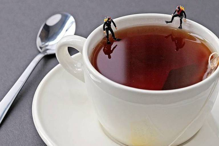 PIC BY CHRISTOPHER BOFFOLI / CATERS NEWS - (PICTURED: Scuba divers in a teacup) - These are the extraordinary every day scenes recreated in miniature on bizarre foodscapes. American artist Christopher Boffoli makes the minuscule creations out of any food substances he can get his hands on at his local grocery store. From eggs to prawn crackers - Christopher sculpts recreations of peoples normal daily life - but substitutes the scenery for food. Christopher, from Seattle, USA, began shooting the project, which he calls Disparity, in 2007. SEE CATERS COPY. Caters / Reporters *** Local Caption *** PIC BY CHRISTOPHER BOFFOLI / CATERS NEWS - (PICTURED: Scuba divers in a teacup) - These are the extraordinary every day scenes recreated in miniature on bizarre foodscapes. American artist Christopher Boffoli makes the minuscule creations out of any food s