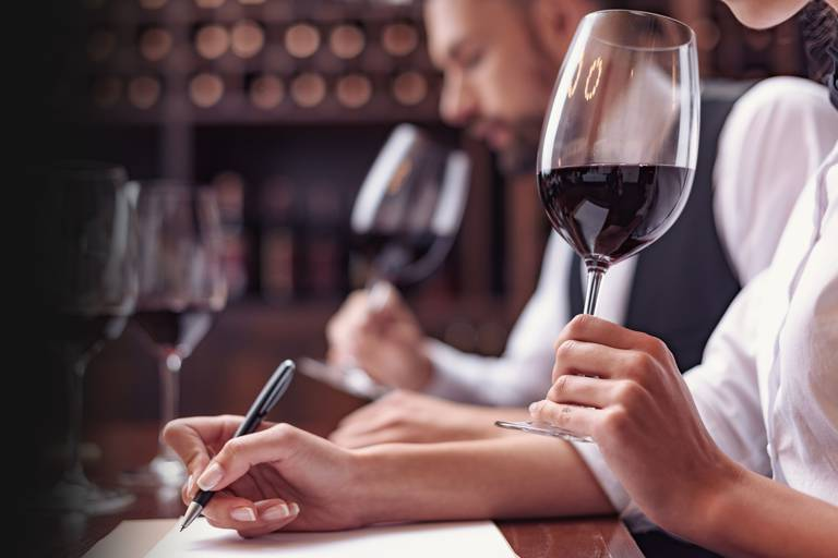 Two,Sommeliers,,Male,And,Female,Tasting,Red,Wine,And,Making