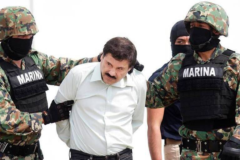 """(150712) -- MEXICO CITY, July 12, 2015 () -- Picture taken on Feb. 22, 2014 shows Mexican drug cartel kingpin Joaquin """"El Chapo"""" Guzman being presented before media at a navy hangar in Mexico City. Drug cartel kingpin Joaquin """"El Chapo"""" Guzman has escaped from a Mexican prison, his second prison breach, local media reported on July 12, 2015. A search operation has been launched, it added. (/David de la Paz) Reporters / Photoshot"""