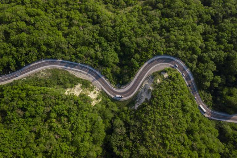 Aerial,Top,View:,Of,Cars,Driving,On,Zig,Zag,Winding