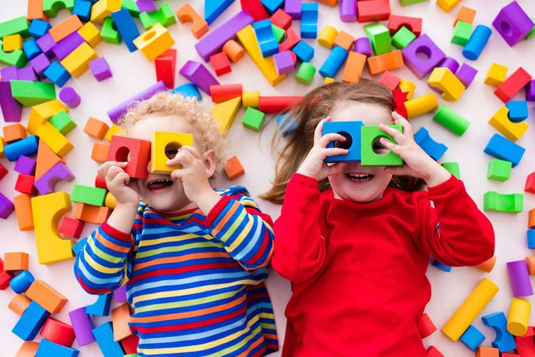 Happy,Preschool,Age,Children,Play,With,Colorful,Plastic,Toy,Blocks.