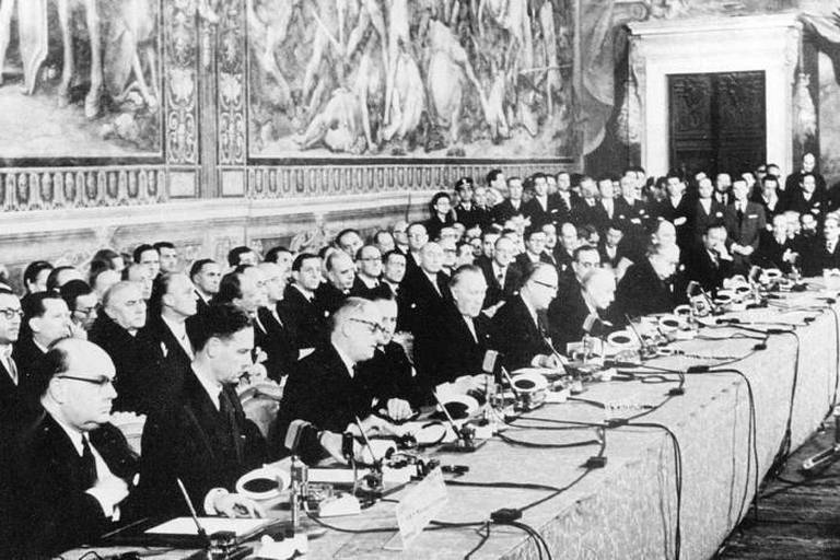 """(FILES) This file photo taken on March 25, 1957 at the Palazzo dei Conservatori on Capitol Hill in Rome shows (from L) Belgium's Foreign Affair minister Paul-Henri Spaak and Belgium's Secretary-General of Economic Affairs Jean-Charles Snoy et d'Oppuers, French Foreign minister Christian Pineau and French State Secretary for Foreign Affairs Maurice Faure, Chancellor of the Federal Republic of Germany Konrad Adenauer and Secretary of State at the German Foreign Office Walter Hallstein, Italian President of the Council Antonio Segni and Italian Foreign Minister Gaetano Martino, Foreign Minister of Luxembourg Joseph Bech and Luxembourg's Ambassador Lambert Schaus, Netherlands' Minister for Foreign Affairs Joseph Luns and Head of the Netherlands Delegation Johannes Linthorst-Homan, signing the treaties instituting the European Economic Community (EEC) and the Euratom Treaty. Europe celebrates on March 25, 2017 the 60th anniversary of the Treaty of Rome which established the """"Common Market"""" for the free circulation of people, goods, services and capital, laying the foundations of the nowadays Europe. / AFP PHOTO / -"""