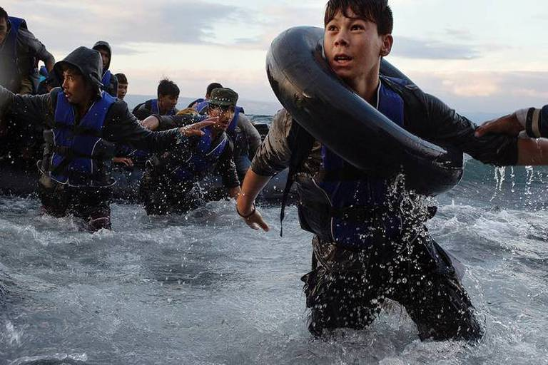 FILE -- After battling rough seas and high winds on the crossing from Turkey, migrants arrive on the northern shore of Lesbos Island in Greece, Oct. 1, 2015. Mauricio Lima, Sergey Ponomarev, Tyler Hicks and Daniel Etter of The New York Times won the 2016 Pulitzer Prize for what the Pulitzer committee said were photographs that captured the resolve of refugees, the perils of their journeys and the struggle of host countries to take them in. (Tyler Hicks/The New York Times) Reporters / Redux *** Local Caption *** 14796352