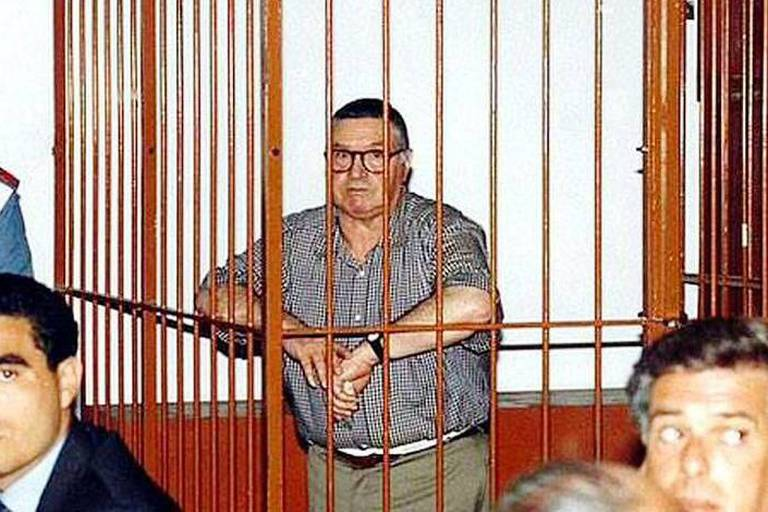 Picture shows : Mafia 'boss of bosses' Toto Riina, 84, on trial in the 90s Mafia 'boss of bosses' Toto Riina, 84, has been hospitalised after his health dramatically worsened according to justice ministry officials. They said that Riina, known as the base who personally is believed to have killed 40 people and ordered the deaths of hundreds more, is currently being treated at a hospital in the northern Italian city of Parma due to his poor health. He is still believed to be in control of the Sicilian Mafia after he became the most powerful member of the criminal organization in the early 1980s. During the 1980s and early 1990s Riina and his Mafia faction, the Corleonesi, waged a ruthless campaign of violence against both rival mobsters and the state, which culminated in the assassination of the antimafia prosecutors Giovanni Falcone and Paolo Borsellino. This caused widespread public revulsion against the Mafia and led to a major crackdown by the authorities, resulting in the capture and imprisonment of Riina and many of his associates. Riina was taken to hospital this month from his imprisonment in the tough '41-bis' high-security prison regime for Italy's most dangerous criminals, although the news only emerged this week. Riina, who is serving out 12 life sentences, has had three heart bypasses and is said to be suffering from back and thyroid problems, as well as suspected prostate cancer. Magistrates believe the Mafia boss still has a big say in running Cosa Nostra even though he has been in jail since 1993. Reporters / CEN LTD