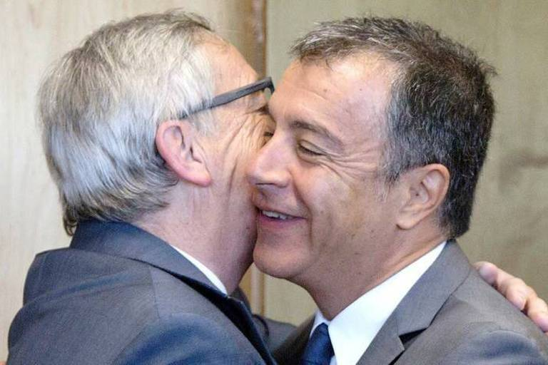 European Commission President Jean-Claude Juncker, left, greets Stavros Theodorakis, leader of the Greek opposition party To Potami, at EU headquarters in Brussels on Friday, July 10, 2015. (AP Photo/Virginia Mayo, Pool)