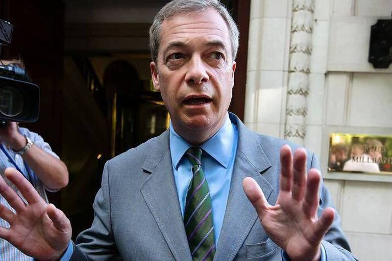 """MEP and former UKIP leader, Nigel Farage gestures in Westminster in central London on June 1, 2017. British politician Nigel Farage on June 1, 2017, dismissed a report that he was a person of interest in the US probe of possible Russian interference in the 2016 election as """"fake news."""" / AFP PHOTO / Daniel Leal-Olivas"""