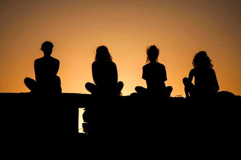 Silhouettes,Of,Girls,At,Sunset