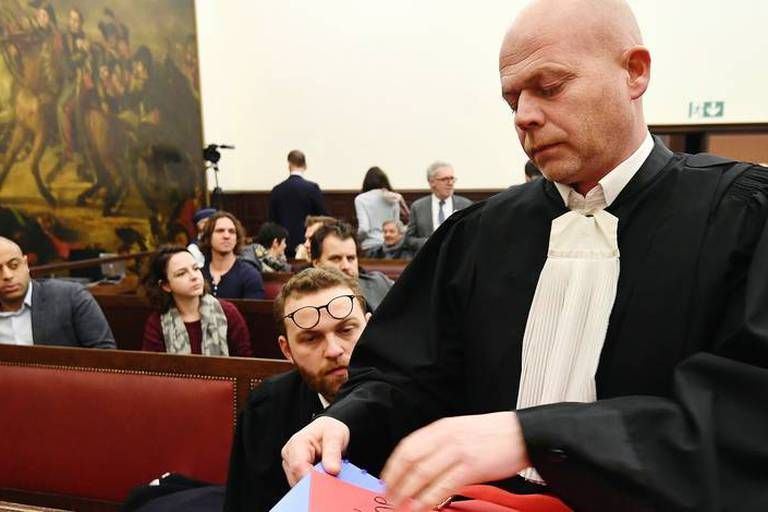 Belgian Lawyer Sven Mary during the trial of Salah Abdeslam at the Brussels Justice Palace in Brussels on Monday, Feb. 5, 2018. Salah Abdeslam and Soufiane Ayari face trial for taking part in a shooting incident in Vorst, Belgium on March 15, 2016. The incident took place when six members of a Franco-Belgian research team investigating the attacks in Paris were conducting a search in an allegedly empty safe house of the terrorists and were attacked. (Emmanuel Dunand, Pool Photo via AP)